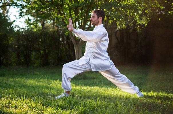 traditional Chinese Tai chi practitioner in white clothing